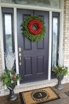 What a simple Christmas door wreath. I would make this using simple pine greens and winterberry (faux, probably).