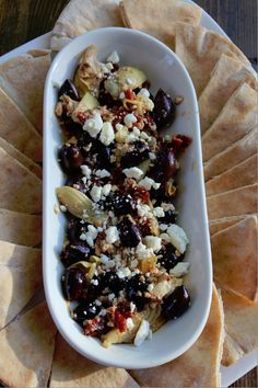 Greek Goddess Appetizer- looks like kalamata olives, artichokes, feta, sun dried tomato and lemon peel