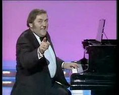Les Dawson, playing the piano