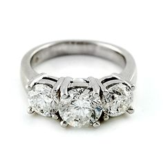 Classic Three Stone Diamond Ring 14 karat white gold diamond ring with three round brilliant diamonds. This timeless style represents the past, present, and future.  1.93ctw