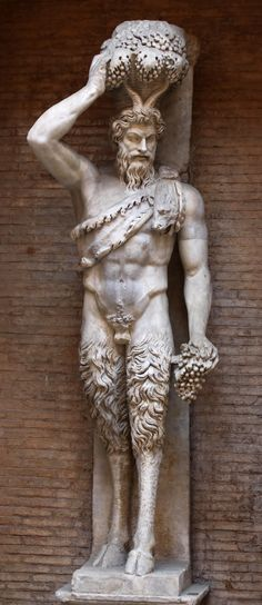 Hellenistic statue of a satyr; a man with a goat's horns and legs, with his attributes of bunches of grapes and an animal skin.