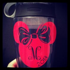 Personalized water bottle for Disney World.  Used Silhouette Cameo for the Minnie Mouse.