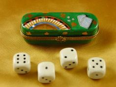 Dice box with four dice
