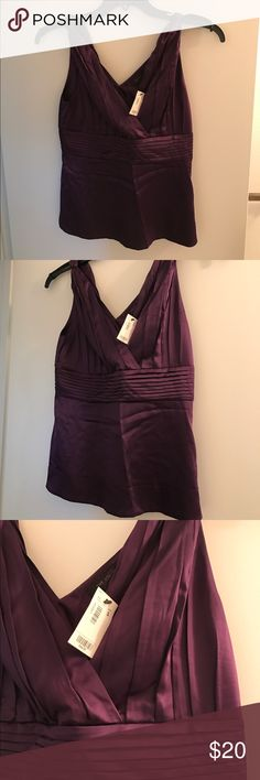 Dressy purple tank from The Limited, nwt. Gorgeous purple tank with pleated detailing at neckline .  V- neck and v-back with twist strap feature. Satin feel, 96% poly, 4% spandex.  Never worn, size s, new with tags. The Limited Tops Blouses
