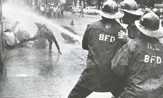 On the orders of Bull Connor, high-pressure firehoses are used against young demonstrators, Birmingham, 1963.