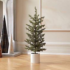 On sale. Shop Potted Pine Tree Standing at two and a half feet tall, this faux pine tree spreads a lot of holiday happiness from its mini form. Potted in a matte white ceramic pot, tree sits perfectly on tabletops or in small spaces. Holiday Tree, Holiday Wreaths, Holiday Decor, Xmas Trees, Holiday Fun, Holiday Ideas, Black Christmas, Christmas Fun, Minimalist Christmas