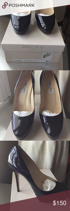 Jimmy Choo patent heels High stiletto heel in 38 1/2. Patent leather in navy (but looks black). Great condition. Original box, worn once or twice. Feminine & sexy Jimmy Choo Shoes Heels