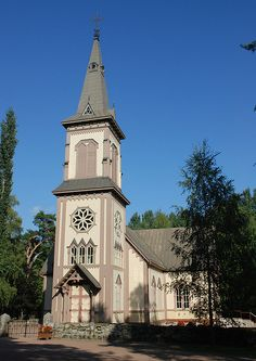 This is the church in Köylio, Finland. It was completed in 1752, and in 1890 the current belfry was built high enough to be seen from all over the parish. On the lakeside of Kirkkosaari-island are the Priest's stairs, (Papinportaat) that the pastor could walk up when coming from the vicarage located on the mainland.