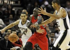 Toronto Raptors forward Mickael Pietrus, center, steals the ball from San Antonio Spurs' Danny Green, left, and Tim Duncan, right, during the second half of an NBA basketball game on Wednesday, Dec. 26, 2012, in San Antonio. The Spurs defeated the Raptors 100-80. (AP Photo/Bahram Mark Sobhani)