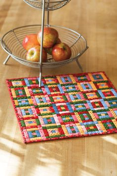 This mini quilt pattern, featuring 36 tiny Courthouse Steps quilt blocks, uses…