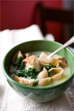 This is a heartier version of garlic soup, a meal in a bowl with a generous egg yolk enrichment and lots of iron-rich spinach.
