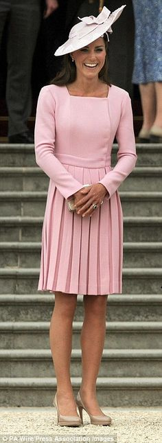 Kate is sugar-almond sweet in a pink dress by Emilia Wickstead at a palace garden party...