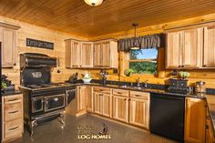 Explore the Eagle III log home: its massive gable dormers are a light lover's dream---love this stove!