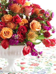 Create a fun wedding centerpiece with a mixture of brightly-colored blooms. More centerpiece ideas: http://www.bhg.com/wedding/centerpieces/beautiful-wedding-centerpiece-ideas/?socsrc=bhgpin073112colorfulmixedweddingcenterpiece
