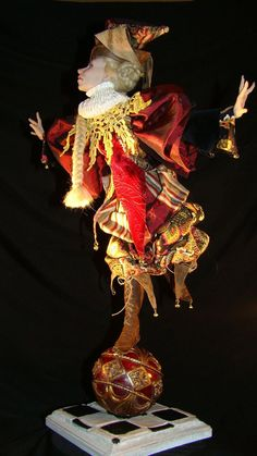 """Jester Artist: Karen Baker One of the members of the Professional Doll Makers Art Guild and most improved artist in the Guild. Queen of Hearts is made of ProSculpt and stands 18"""" tall."""