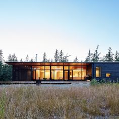 Toronto-based architect Nova Tayona has completed an beachfront house in Nova Scotia, from which the ocean can be heard but not seen