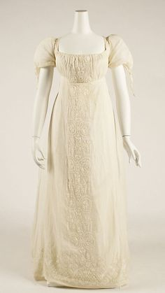 Dress, Evening    Date:      1805–9  Culture:      European  Medium:      cotton  Dimensions:      Length (from front shoulder): 50 1/4 in. (127.6 cm)  Credit Line:      Gift of Jane Durando Miller, 1977  Accession Number:      1977.293.1