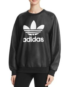 Sport old-school cool with this slick faux-leather sweatshirt from adidas Originals, emblazoned with the label's iconic trefoil logo.   Polyurethane; lining/trim: polyester/cotton   Machine wash   Imp