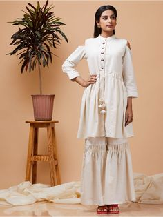 Off White Cold Shoulder Smocked Cotton Kurta with Garara - Set of 2 Indian Gowns Dresses, Pakistani Dresses, Indian Outfits, Pakistani Garara, Fashion Pants, Fashion Outfits, Women's Fashion, Suits For Women, Clothes For Women