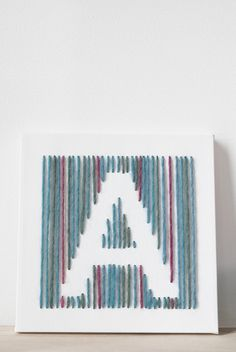 DIY canvas art with yarn. Sew on a letter on canvas. A perfect DIY gift idea for both kids and adults