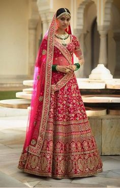 This fuschia colour wedding lehenga set is inspired by Sabyasachi Collection.Lehenga set is in raw silk fabric with zardozi, marodi and arrihand embroidery. This lehenga set comes with 2 dupattas as shown in the photo.