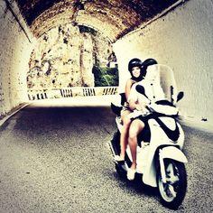Via Roma moped couple