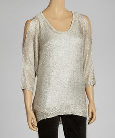Get ready to shimmer and sizzle. This super-sparkly cutout top will not only turn heads, it'll shoot any fashionable woman to the top of the style list.