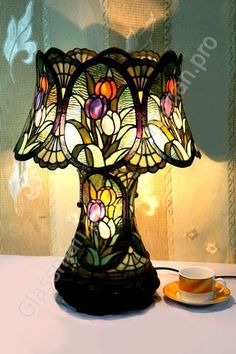 Table lamp is a small lamp designed to stand on a table. Adding elegance to your home decor could easily be achieved with the smallest thing such as adding a table lamp. Tiffany Stained Glass, Stained Glass Lamps, Tiffany Glass, Stained Glass Projects, Leaded Glass, Mosaic Glass, Chandelier Design, Chandelier Lamp, Chandeliers