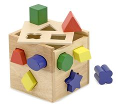 Age: 2+  Shape Sorting Cube. Sturdy wood construction, 12 wooden shapes.