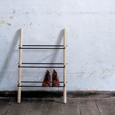 The Stick shoe rack by Norrmade made of oiled/black ash is simply leaned on the wall. Shoe Shelves, Shoe Storage, Small Furniture, Buy Shoes, Shoe Rack, Ladder Decor, Ash, Stuff To Buy, Interiors