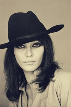Dark-lined eyes and brimmed hat of Anna Karina -- muse of Jean-Luc Goddard