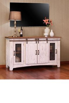 100% solid pine, great durability, and value. This rustic tv stand features rolling barn doors, and a distressed, hand-applied finish. Two-tone, multi-step lacquer finish. The weathered white finish on hand- distressed wood. The solid wood construction will provide years of service with its unique look. Mortise and tenon construction ensures stability and durability on all pieces. Solid wood floated tops allow for wood's natural movement. Non-chip, custom pulls are durable and unique. #tvstand
