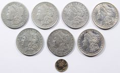 Lot 20: Morgan $1 Assortment; Seven coins; together with a silver dime