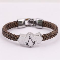 Amazon.com: Generic Assassin's Creed Pu Leather & Alloy Wristband Brown Bracelet: Jewelry