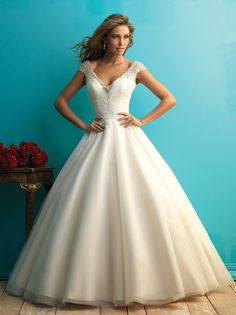 Deep v neckline on the cap sleeves bodice, tulle ball gown wedding dress finished with open low back while beaded on the bodice.