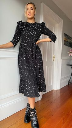 We're totally loving this black star print ruffle smock dress.