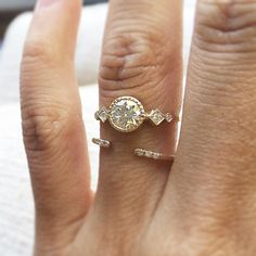 JENNIE KWON custom engagement ring with Equilibrium Cuff (Instagram: @jenniekwondesigns)