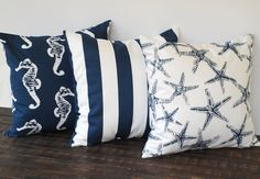Throw pillow covers 16 x 16 inches set of three cushion covers decorative pillows new navy blue and white nautical beach decor. $48.00, via Etsy.