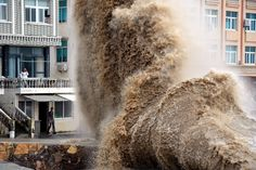A wave crashes into Shitang Township in China's Zhejiang province on Sunday. High waves were seen in the region due to the effects of Typhoon Vongfong and a strong cold front coming from western China. Jin Yunguo/Xinhua/Zuma Press