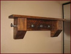 A coat rack I made from reclaimed rail road spikes and rough sawn timber.