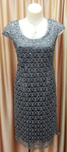 Dress short sleeve Small sequence through the silver/grey lace Long satin jacket with paper taffeta Fully lined Colour: Silver/Grey Size: 10 - 24 FROM 10-20