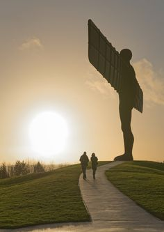 https://flic.kr/p/DipJEs   _AS13983 Angel of the North Gateshead photo visitors Aaron Sneddon   Angel of the North sculpture near Gateshead and Newcastle Upon Tyne. Sir Antony Gormley created this huge imposing statue which sits above coal minings. Angel of the North sculpture near Gateshead and Newcastle. Facts: The project was completed in 1998, it took 4 years to create. Thankfully, the sculpture is designed to withstand high winds, It took 600 Tonnes of concrete to secure it in the…