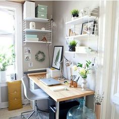 Shelves, boxes, and just having a spot for everything can make an office feel way more organized. | 18 Home Offices That Will Give You New Decor Goals