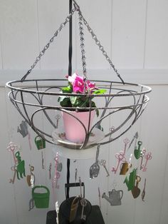 Potted Hanging Wind Chime - I love this look of nature along with the the soft zen sounds of the metal charms and keys in my garden.