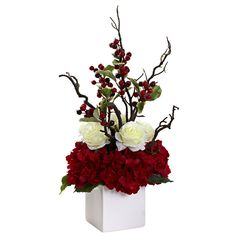 For the holidays or other occasions, this floral arrangement is complete with roses, hydrangeas and decorative branches with berries. Brighten up your room with this floral display including a white ceramic vase.