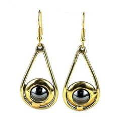 Shine On Hematite Earrings Handmade and Fair Trade. Delicate teardrops of brass hold hematite stones encased in polished brass in these earrings that are handmade by South African artisans. Dimensions: 20 mm wide x 35 mm long.