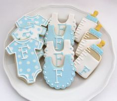 **PLEASE CONTACT ME BEFORE ORDERING TO BE SURE I AM AVAILABLE. I bake and decorate each cookie myself and I need to be sure I have time to make you the most delicious and beautiful cookies possible. When you contact me, include the date of your event, quantity of cookies needed, and zip code.**   These personalized baby cookies are perfect for a baby shower or a baby gift.  Includes: 4 Onesies 4 Bibs 4 Bottles   **LOCAL CUSTOMERS: Use coupon code LOCALORDER to avoid shipping charges. I do…
