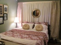 Asymmetrical window wall behind a bed? Hide it with drapes! It doesn't need to be expensive, either. Use inexpensive bed sheets as curtains--the hem works great as a curtain rod pocket!