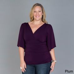 Accentuate your positive features with one of these plus-size flutter-sleeve tops by Kiyonna. This top features flattering low-cut front and back necklines, along with a shirred waist. This pullover shirt has flutter sleeves for added appeal.