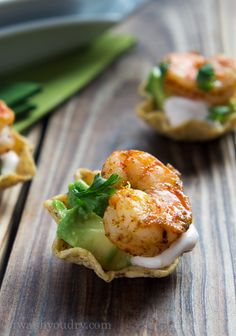 Shrimp Taco Bites. Seasoned shrimp in scoop tortilla chip with sour cream, cilantro, and avocado. Great appetizers